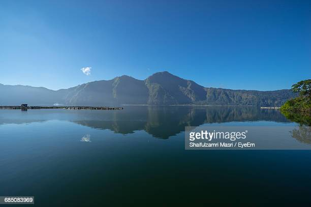 Scenic Reflection Of Mountain Range In Lake