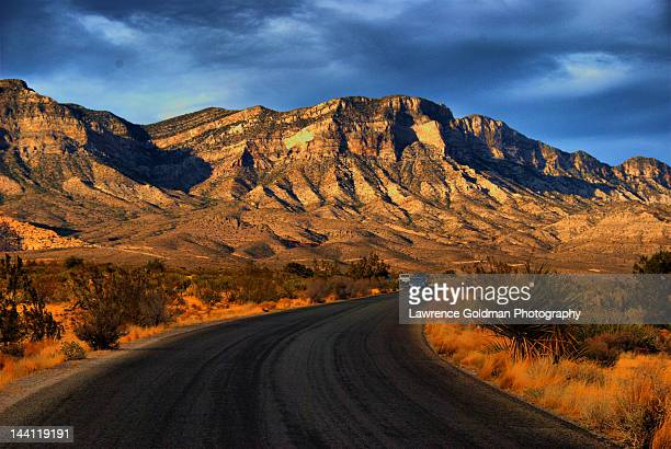 scenic road framed by gold - red_rock,_nevada stock pictures, royalty-free photos & images
