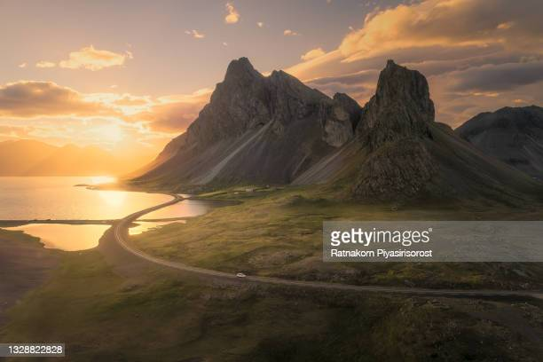 scenic road in iceland, beautiful nature landscape aerial panorama, mountains and coast at sunset - iceland stock pictures, royalty-free photos & images