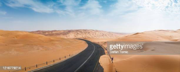scenic road in uae desert in the middle east - abu dhabi stock pictures, royalty-free photos & images