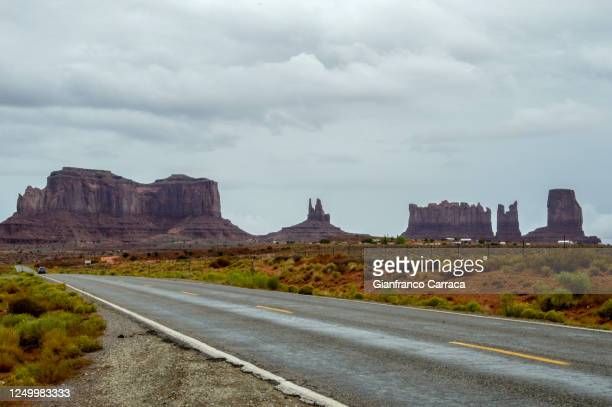 scenic road near the monument valley - arizona stock pictures, royalty-free photos & images