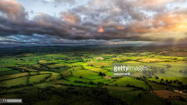 scenic rural landscape. sunset time - ireland stock pictures, royalty-free photos & images
