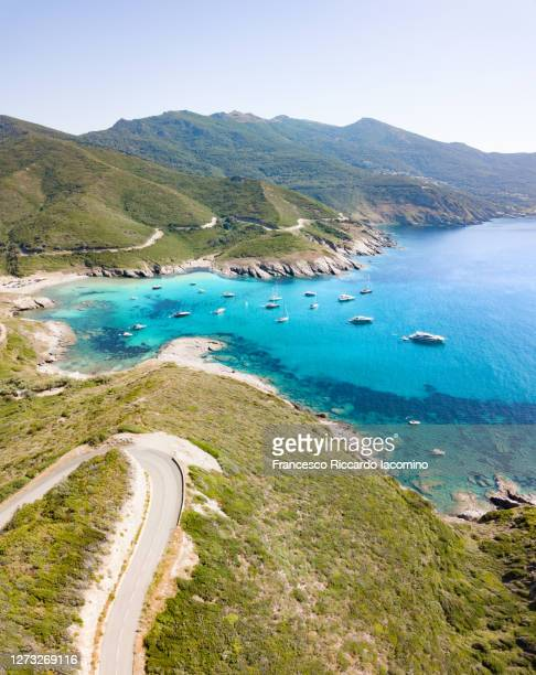 scenic seascape and road near anse d'aliso, corsica, france - francesco riccardo iacomino france foto e immagini stock