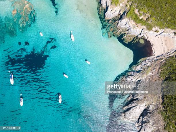scenic seascape near anse d'aliso, corsica, france, directly above view on water and boats - francesco riccardo iacomino france foto e immagini stock