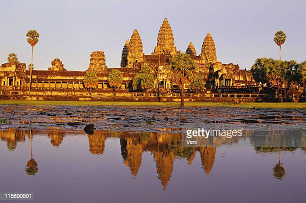 scenic shot capturing the beauty of angkor wat in cambodia - wat stock pictures, royalty-free photos & images