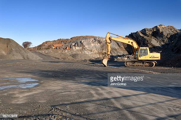 scenic shot of a quarry being dug - caterpillar stock pictures, royalty-free photos & images