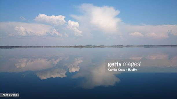 Scenic shot of reflection of clouds in lake