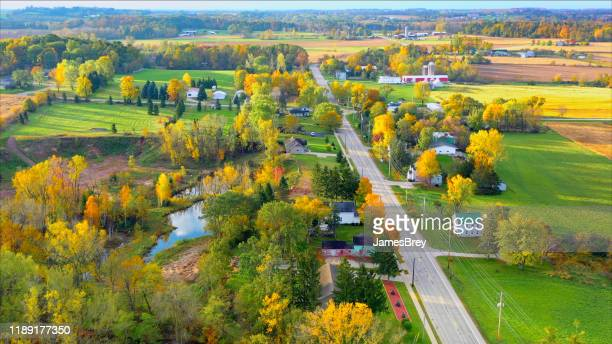 scenic small town nestled amid fertile valley in beautiful rural wisconsin - wisconsin stock pictures, royalty-free photos & images