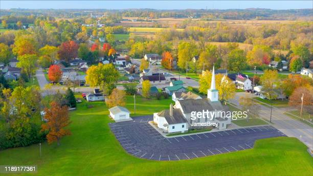 scenic small town nestled amid fertile valley in beautiful rural wisconsin - small town stock pictures, royalty-free photos & images