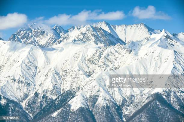 scenic snow-capped mountains - cliqueimages stockfoto's en -beelden