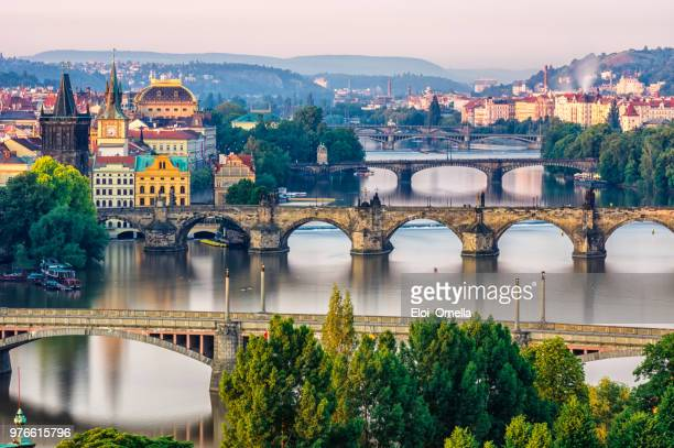 Scenic spring sunrise aerial view of the Old Town pier architecture and Charles Bridge over Vltava river in Prague, Czech Republic