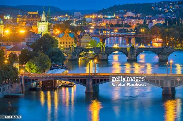scenic spring sunset aerial view of the old town pier architecture and charles bridge over vltava river in prague, czech republic - vltava river stock pictures, royalty-free photos & images