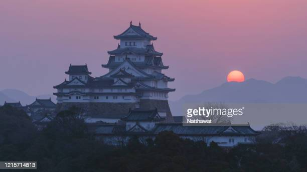 scenic sunrise view of himeji castle, japan - 兵庫県 ストックフォトと画像