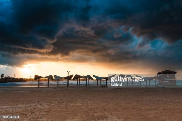 Scenic sunset on empty Mediterranean beach during stormy winter evening