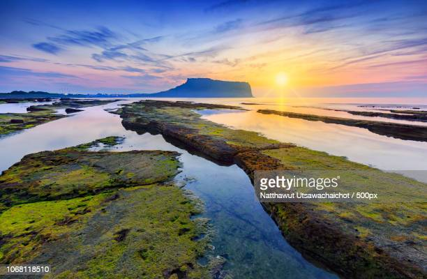 scenic sunset over seascape - jeju stock photos and pictures