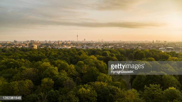 scenic sunset view volkspark friedrichshain park and berlin cityscape, germany - treetop stock pictures, royalty-free photos & images
