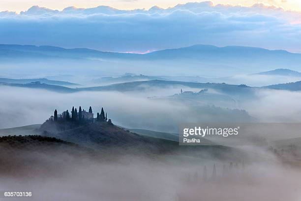 scenic tuscany landscape at sunrise, val d'orcia, italy - siena italy stock photos and pictures