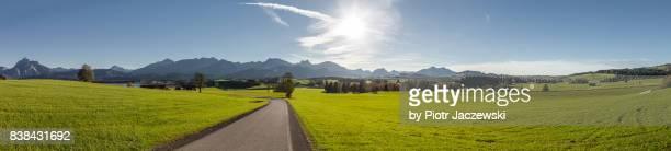 scenic ultra-wide panorama of mountains - panoramic stock-fotos und bilder