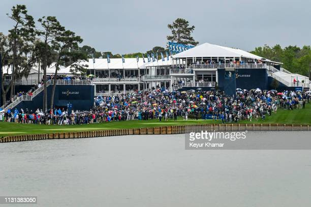 A scenic view as fans follow the group of Tiger Woods and Matthew Fitzpatrick of England on the 18th hole during the final round of THE PLAYERS...