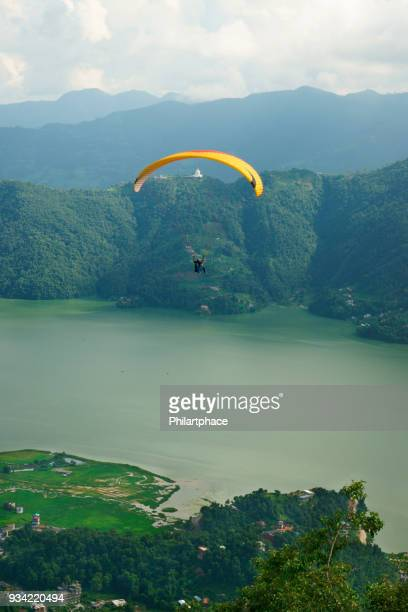 scenic view at pokhara lake mountain range and paraglider - pokhara stock pictures, royalty-free photos & images