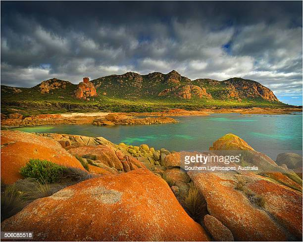 a scenic view at the docks, a colourful area of coastline on flinders island, part of the furneaux group, eastern bass strait, tasmania. - cotes d'armor stock photos and pictures
