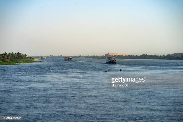 scenic view boat and cruise ship sailing along Nile river from luxor to aswan city  egypt