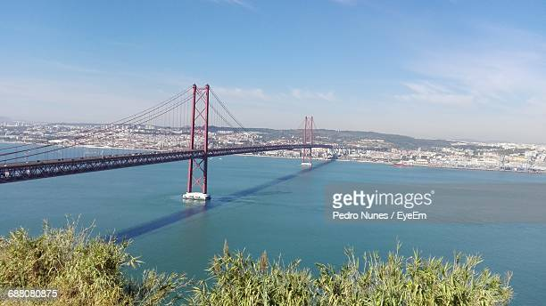 Scenic View Of 25 De Abril Bridge Over Tagus River Against Sky