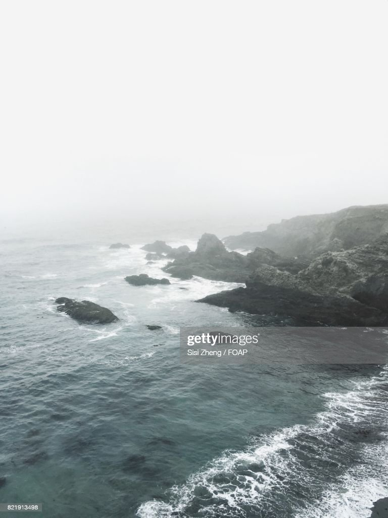 Scenic view of a beach on fog : Stock Photo