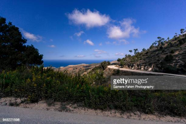 scenic view of a coastal landscape against clear sky - samere fahim stock photos and pictures