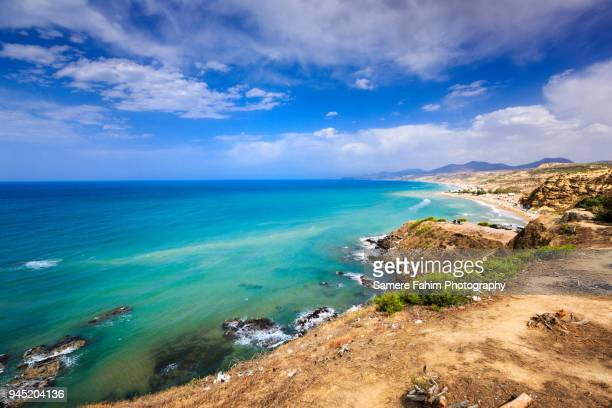 scenic view of a coastal landscape against cloudy sky - algerie photos et images de collection