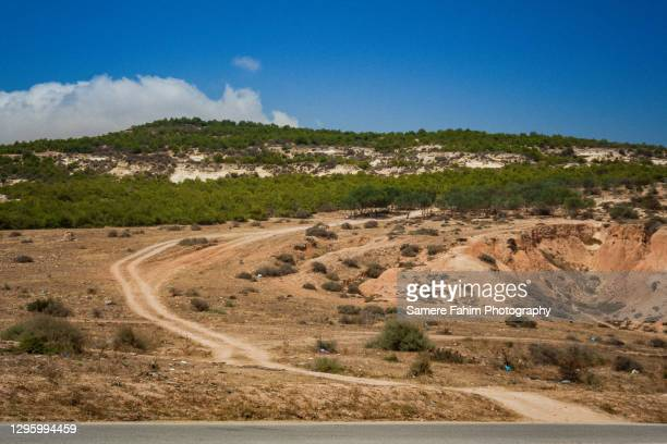 scenic view of a dirt road on a hill against a clear sky - 2007 stock pictures, royalty-free photos & images