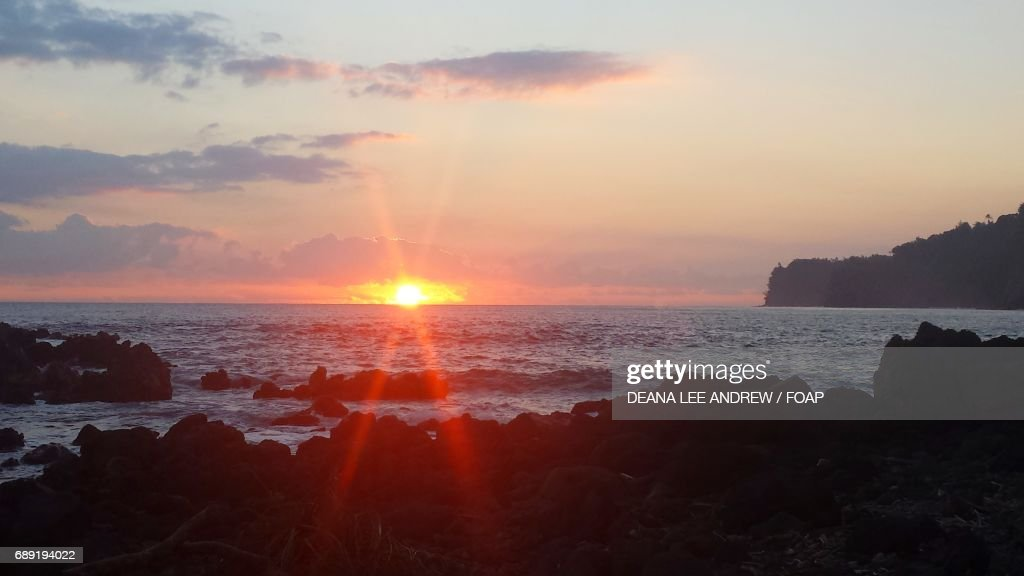 Scenic view of a sea at sunset : Stock Photo