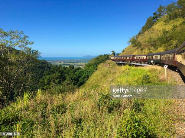 Scenic view of a train passing along a hillside