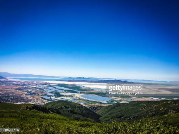 scenic view of agricultural field against blue sky - great salt lake stock pictures, royalty-free photos & images