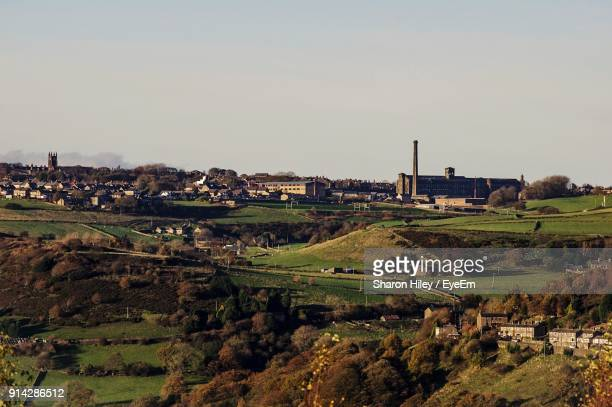 scenic view of agricultural field against clear sky - bradford england stock pictures, royalty-free photos & images