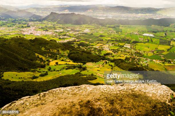 scenic view of agricultural field against mountains - cundinamarca stock pictures, royalty-free photos & images
