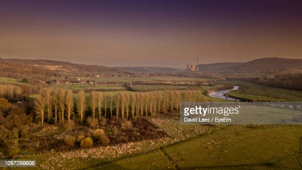 scenic view of agricultural field against sky during sunset - ironbridge shropshire stock pictures, royalty-free photos & images
