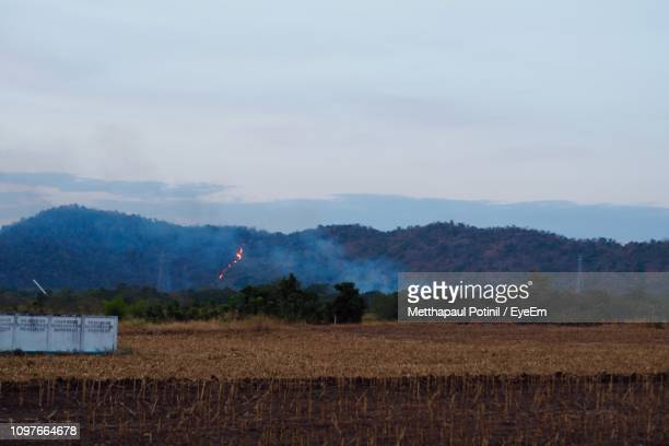 scenic view of agricultural field against sky - metthapaul stock photos and pictures