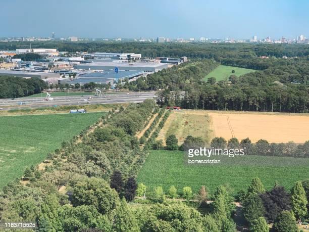 scenic view of agricultural field against sky - bortes fotografías e imágenes de stock