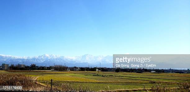 scenic view of agricultural field against sky - 富山県 ストックフォトと画像