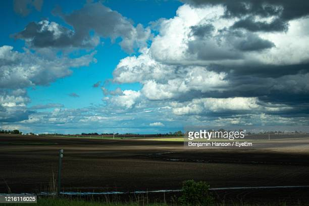 scenic view of agricultural field against sky - illinois stock pictures, royalty-free photos & images