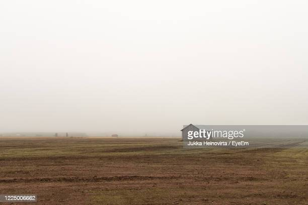 scenic view of agricultural field against sky - heinovirta stock pictures, royalty-free photos & images