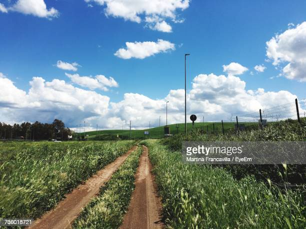 scenic view of agricultural field against sky - ciampino airport stock photos and pictures