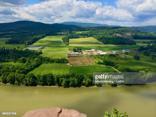 scenic view of agricultural field against sky - pennsylvania stock pictures, royalty-free photos & images