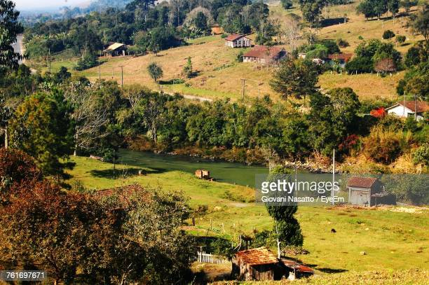 Scenic View Of Agricultural Field And Houses