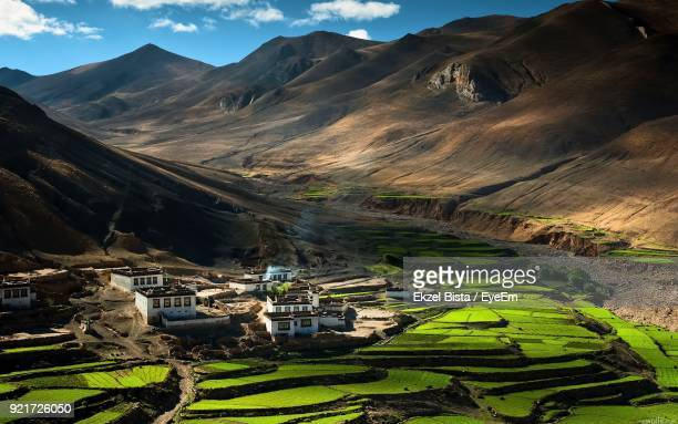 scenic view of agricultural field and mountains against sky - sikkim stock pictures, royalty-free photos & images