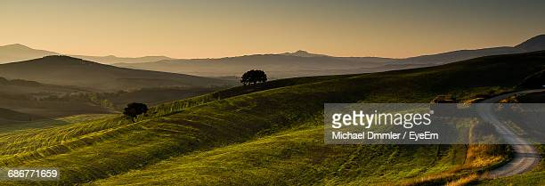 Scenic View Of Agricultural Landscape Against Clear Sky