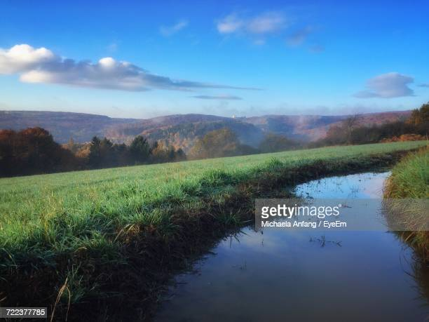 scenic view of agricultural landscape against sky - anfang stock pictures, royalty-free photos & images