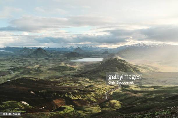 scenic view of alftavatn lake valley at sunset - horizontal stock pictures, royalty-free photos & images