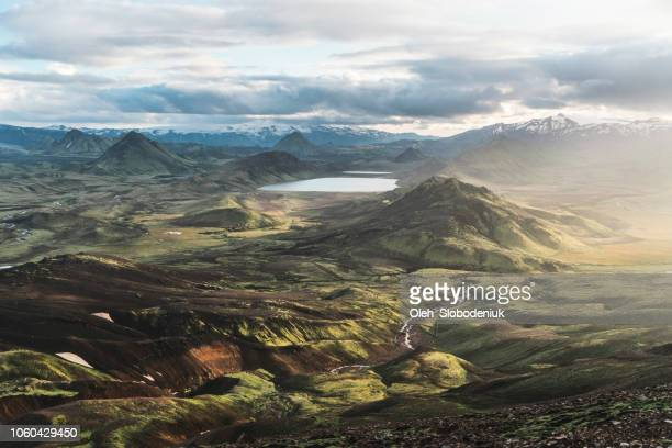 scenic view of alftavatn lake valley at sunset - dramatic landscape stock pictures, royalty-free photos & images